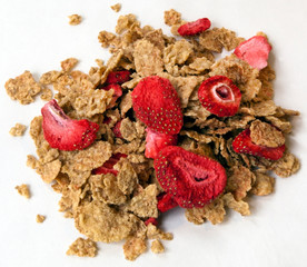 Pile of healthy grain cereal with freeze-dried strawberries.