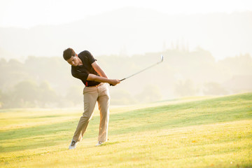 Asian man golfer playing golf at golf course