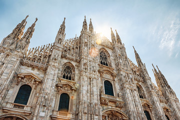 Fototapete - Milan Cathedral (Duomo di Milano) in sunlight, Italy. It is a top landmark of Milan. Beautiful facade of nice Milan Cathedral on sunny summer day.