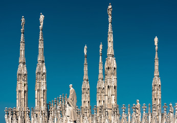 Fototapete - Milan Cathedral roof, Italy. Famous Milan Cathedral or Duomo di Milano is top tourist attraction of Milan.