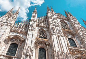 Fototapete - Milan Cathedral (Duomo di Milano), Italy. It is famous landmark of Milan city. Luxury facade of Milan Cathedral close-up.