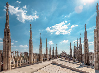Fototapete - Milan Cathedral roof on sunny day, Italy. Milan Cathedral or Duomo di Milano is top tourist attraction of Milan.