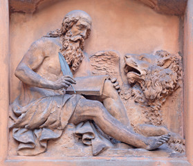 MODENA, ITALY - APRIL 14, 2018: The terracota relief of St. Mark the Evangelist in the house facade.