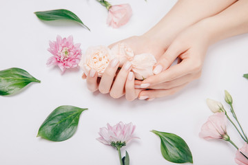 Concept beauty skin care. Beautiful stylish trendy female pink manicure with flower on background, top view Fotomurales
