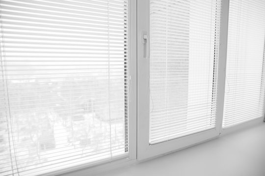 White plastic window upvc angle, detailed design with shutters blinds