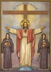 REGGIO EMILIA, ITALY - APRIL 12, 2018: The relief of resurrected heart of Jesus Christ with the St. Clara and Veronica in church Chiesa dei Cappuchini.