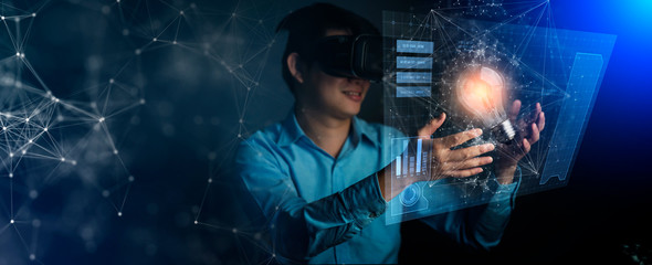 young asian technician man working and hand touch effect of magic from Virtual reality hand touch virtual light bulb and device screen creative ideas concept Wall mural