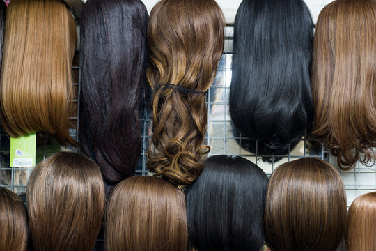 Different wigs for sale on market.