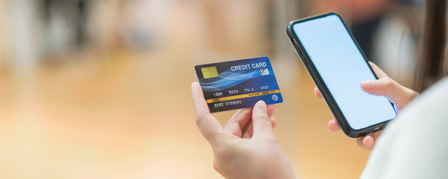 Banner of Closeup Asian women using mobile phone application for online shopping in department store , Online payment concept, credit card mockup