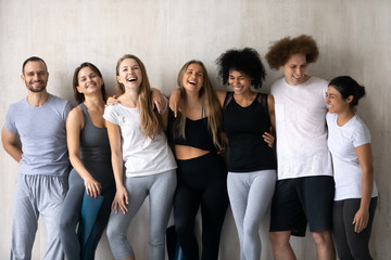 Happy diverse people having fun after group yoga lesson