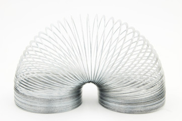 shiny metal slinky isolated on a white background