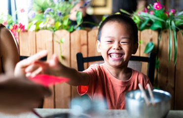 Chinese boy receiving red pocket on the table