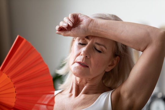 Close up of senior woman suffering from heatstroke at home