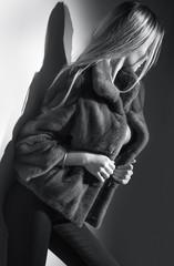 Beauty Fashion Model Girl in Mink Fur Coat black and white portrait. Beautiful Woman in Luxury...