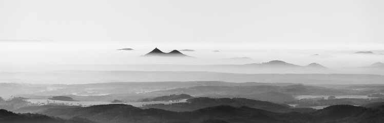 Foto auf Leinwand Weiß Bezdez twin mountains rising from the mist. Weather temperature inversion, Czech Republic