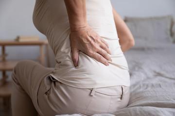 Close up of unhealthy elderly woman having backache
