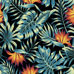 Tropical vintage floral palm leaves orange strilitzia flower seamless pattern black background. Exotic jungle wallpaper.