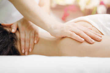 Massage of neck for woman in salon beauty spa