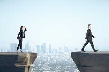 Businesswoman looking on businessman standing on mountain.