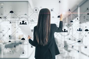 Young woman drawing social network interface Wall mural