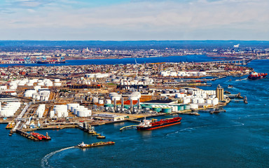 Aerial view of Dry Dock and Repair and Port Newark and Global international shipping containers, Bayonne, New Jersey. NJ, USA. Harbor cargo. Staten Island with St George Ferry terminal, New York City Fotomurales