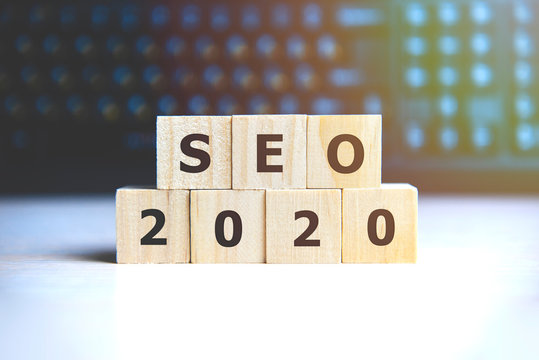 Seo 2020 concept. Wooden cubes on a black keyboard