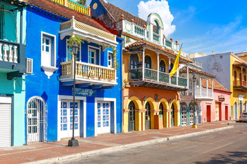 Spoed Fotobehang Oude gebouw Cartagena, Colombia – 18 December, 2019: Scenic colorful streets of Cartagena in historic Getsemani district near Walled City (Ciudad Amurallada)