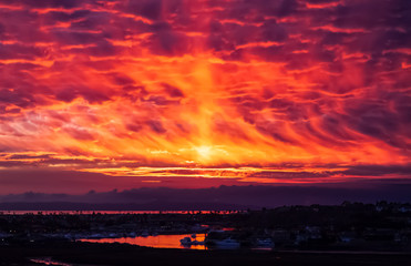Self adhesive Wall Murals Coral fiery sunset reflected in water in Newport Beach California