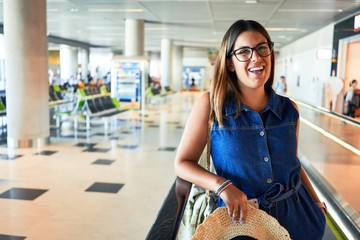 Young traveller woman at the airport going on vacation