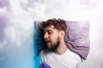 Man sound asleep , enjoying his nap, graphic clouds added , dreaming
