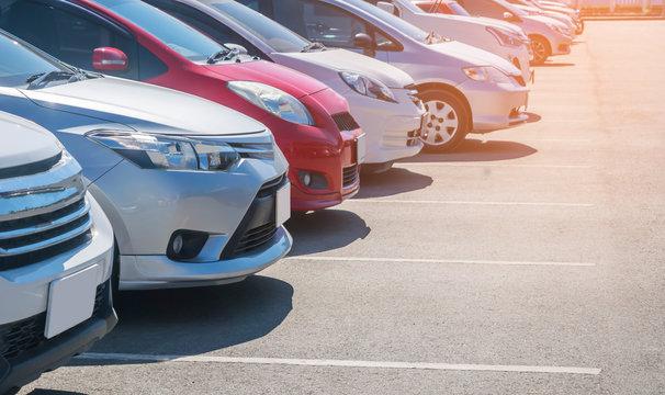 Car parking in asphalt parking lot in a row