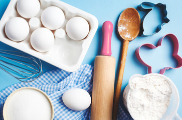 Easter baking. Ingredients and kitchen items for baking. Kitchen utensils, flour, eggs, sugar. Top view.