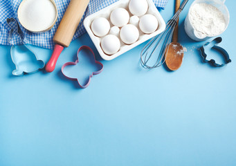 Baking background frame. Preparation for Easter baking. Ingredients and kitchen items for baking. Kitchen utensils, flour, eggs, sugar. Top view, copy space