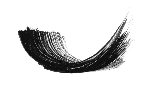 Black mascara brush stroke smear smudge isolated on white background. Makeup swatch. Cosmetic product creamy texture