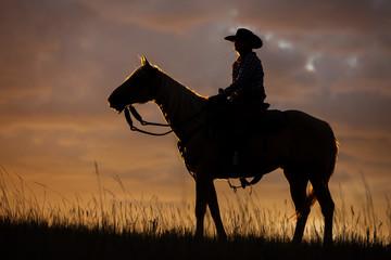 Zelfklevend Fotobehang Diepbruine Cowgirl Silhouette