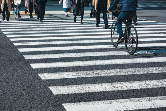 People walking and Cycling on Crosswalk City street Traffic sign Urban lifestyle Smart city