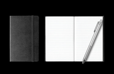 Closed and open notebooks with pen isolated on black