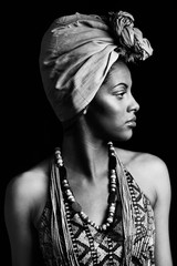 african black young woman portrait with turban headscarf studio shot black and white