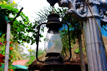old lantern lamp hanging on the wall
