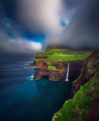 Wall Mural - Gasadalur village and Mulafossur waterfall on Faroe Islands, Denmark