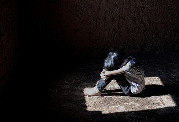 human trafficking concept, Helpless girl sitting on floor old room,children violence and abused...