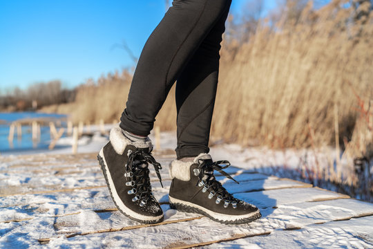 Snow boots fashion footwear for winter season girl wearing black leather ankle shoes.