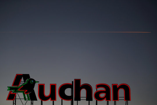 The logo of Auchan is seen on the roof of an Auchan supermarket in Escaudoeuvres