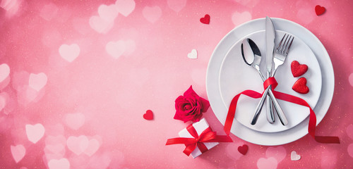 Red table setting cutlery for valentines days dinner