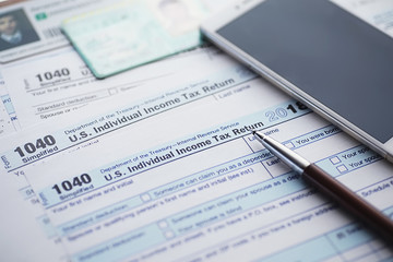 Annual tax reporting. Tax form on the table. Financial statements for signature.
