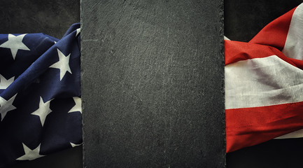American flag on a black background. Space for text.