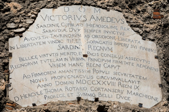 Memorial marble plaque to Victor Amedeus, King of Sardinia, fighting for Sardinia Independence in the XVIII century. It is written in latin language. Cagliari, Italy.