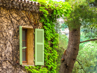 Window in old stone house. Saint-Paul de Vence, France