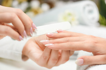 Photo sur Toile Manicure Nails manicure with file. Woman beautiful nail care. after filling.