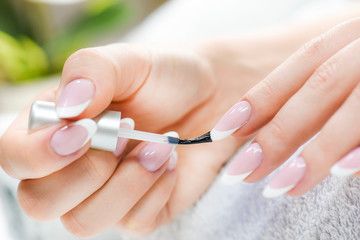 Poster de jardin Manicure Beautiful manicure nails paint. Woman in nail salon applying manicure..Close up of nails varnish.